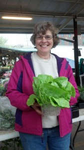 Karlene Goetz shares lettuce and a smile